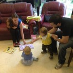 Zoe and Tyler are more interested in the wrapping paper than the jigsaw it contained (Tyler's present to Zoe).