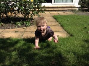 Zoe crawls in the garden