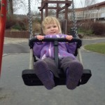Zoe still loves the swings.